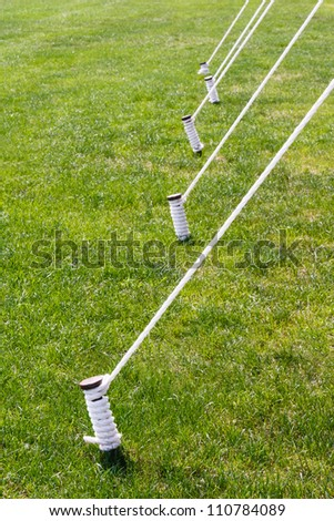 Tent stakes also known as tent pegs are wrapped and tied with white rope set against & Tent Stakes Known Tent Pegs Wrapped Stock Photo 110784089 ...