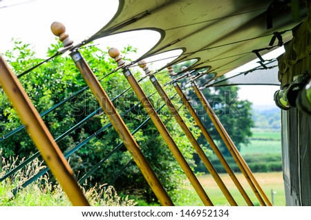 Tent stakes also known as tent pegs securing a large glamping tent - stock photo