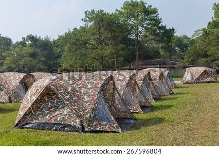 Tent to camp on the edge of a forest. - stock photo