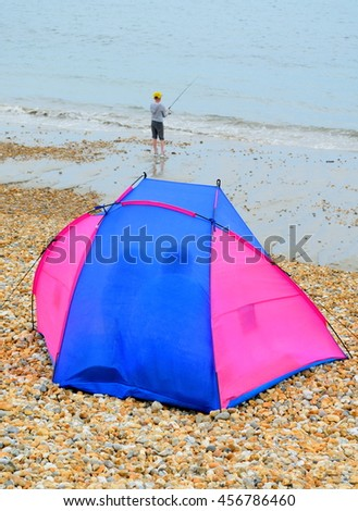 Tent with fisherman on the Jurassic Coast, England - stock photo