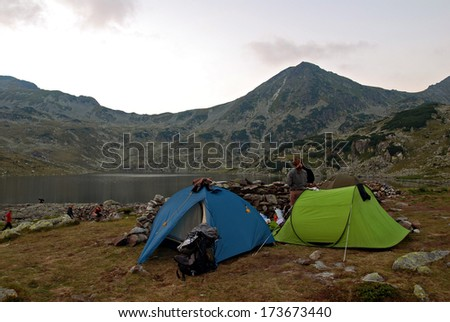 Tents and hikers in the Retezat National Park (Transylvania - Romania) - stock photo
