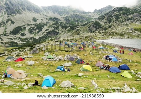Tents and hikers in the Retezat National Park (Transylvania - Romania). - stock photo