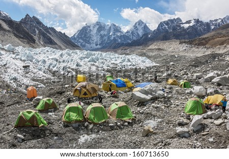 Tents climbers are on the Khumbu glacier near legendary place Everest Base Camp - Nepal, Himalayas - stock photo