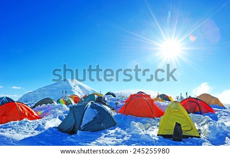 Tents of climbers high in the mountains - stock photo