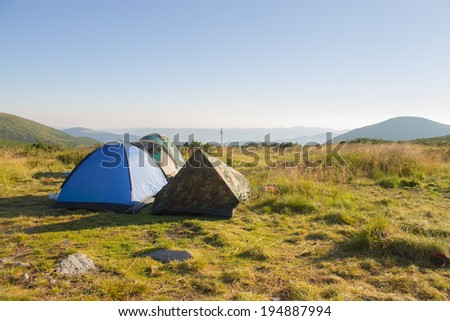 tents on mountains landscape
