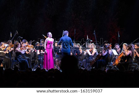 TEOS - IZMIR-JUNE 31: Turkish - Greek orchestra, Maestro Cem Mansur. The city of first actors union was (BC. 2000) the ancient city of Teos, on June 31 2013 in Teos izmir Turkey