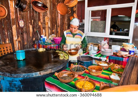 TEOTIHUACAN, MEXICO - DEC 4, 2015: Mexican restaurant chef in Teotihuacan, Mexico on Dec 4, 2015. Mexican food is well-known for its exotic flavors and the use of strong spices. - stock photo