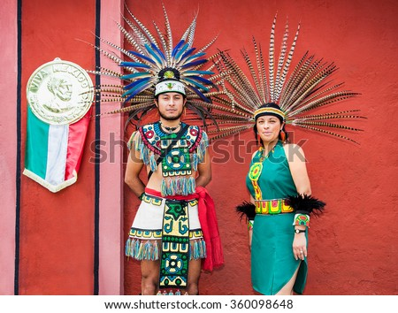 TEOTIHUACAN, MEXICO - DEC 4, 2015: People from Maya tribe in traditional costume in Teotihuacan, Mexico on Dec 4, 2015. Mayan people are of the Mesoamerican civilization.