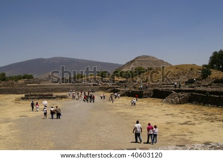 TEOTIHUACAN, MEXICO - MARCH 29: Pyramid of the Sun in Teotihuacan pyramid complex on March 29, 2009 in Mexico. It's is a huge archaeological site with extensive pre-Columbian pyramidal structures - stock photo