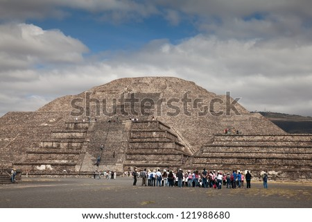 TEOTIHUACAN, MEXICO - NOVEMBER 17: Pyramid of the Moon on November 17, 2012 in Teotihuacan, Mexico. Teotihuacan is an enormous archaeological site in the Basin of Mexico, northeast of Mexico City. - stock photo
