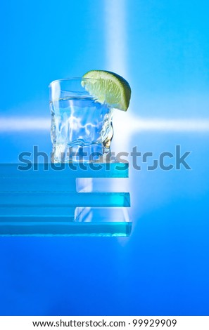 tequila and lime on a glass.