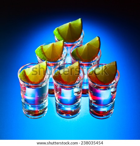 tequila and lime on a glass table