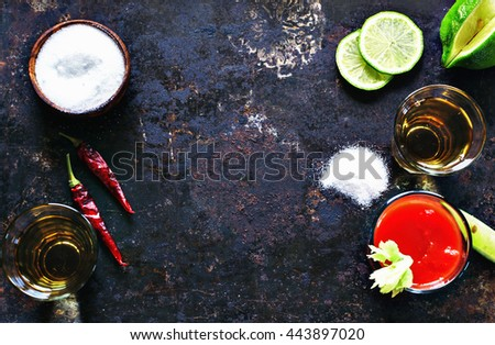 Tequila gold with sangrita chaser shots with lime slice with free text space, top view. - stock photo