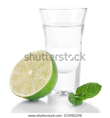 Tequila in glass isolated on white - stock photo