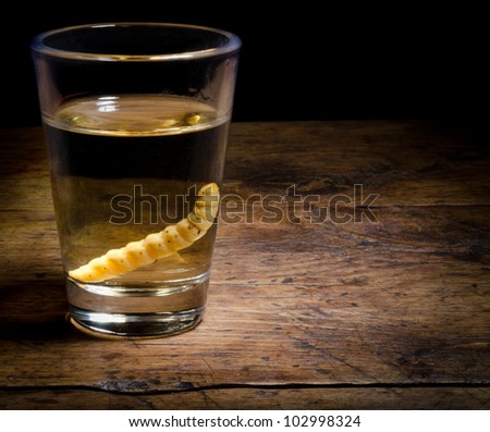 Tequila on vintage background. - stock photo