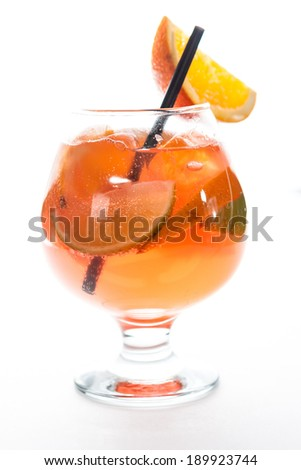 tequila sunrise with orange in a hurricane glass - stock photo