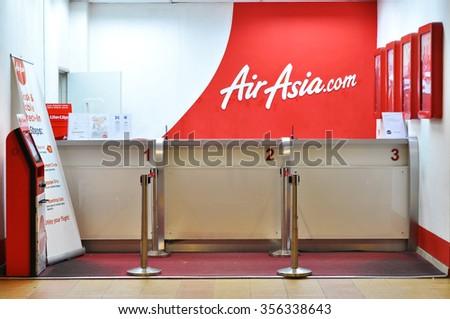 TERENGGANU, MALAYSIA - DECEMBER 30, 2015 : Very stylish and elegant Airasia ticket counter at Sultan Mahmud Airport at Kuala Terengganu, Terengganu.