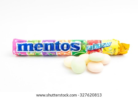 TERENGGANU, MALAYSIA - October 11th, 2015 : Mentos assorted chewy dragees with strawberry, apple, grape, orrange, kiwi, and cranberry. -stock photo