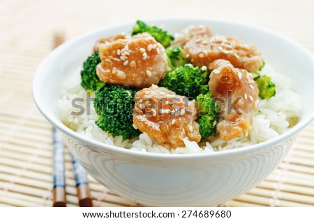 teriyaki chicken and broccoli stir fry with rice. the toning. selective focus - stock photo