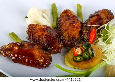 Teriyaki chicken wings with herbs and spices