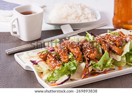 teriyaki chicken with salad and rice on tray - stock photo