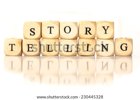 Term Story Telling spelled from toy cubes, dice letters with reflection on bottom. Studio shot on White background. - stock photo