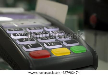 Terminal cashless payment, credit card - stock photo