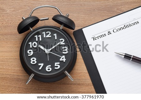 Terms and conditions words, conceptual,book,pen and clock on wood - stock photo