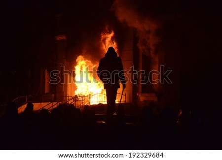 TERNOPIL, UKRAINE- FEBRUARY 18: Protestants pelted police with stones, and then burned police department on the Night of anger on February 18, 2014 in Ternopil, Ukraine (riots, terrorism, arson).