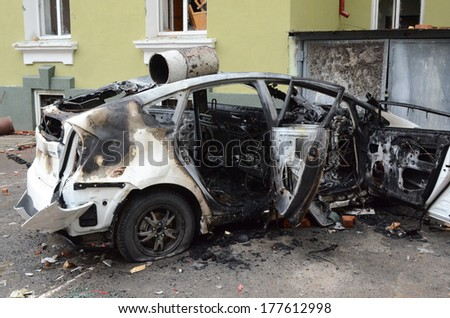TERNOPIL, UKRAINE- FEBRUARY 18: Result of assault of city police department by activists Ukrainian revolution on February 18, 2014 in Ternopil, Ukraine. Protestants burned police department and cars.