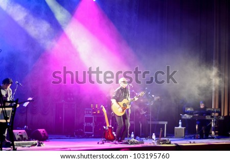 """TERNOPIL, UKRAINE - MAY 19: Christian rock band """"Briksa and Friends"""" performs at the concert on May 19, 2012 in Ternopil, Ukraine. - stock photo"""