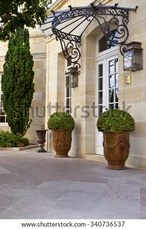 Terrace and garden in the courtyard of a French mansion