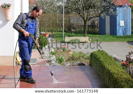 Terrace cleaning with high-pressure - stock photo