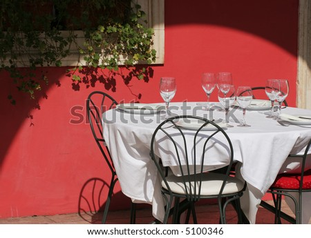 Terrace of red wall restaurant in the morning