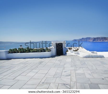 Terrace on Santorin island with a view on azure Mediterranean sea. - stock photo