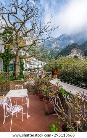 Terrace on  villa at Positano village, over surrounding mountains. - stock photo