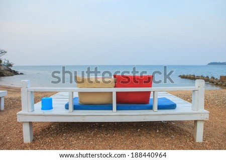 Terrace sea view with outdoor wood chairs - stock photo