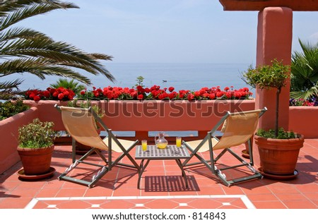 Terrace, table, chairs of luxury apartment and sea views to the mediterranean sea in Spain