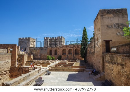 Terrace, towers and wall of medieval Alcazaba fortress of Alhambra, Granada, Spain - stock photo