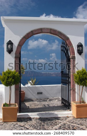Terrace with a door to the sea. View to the caldera in Santorini island, Greece - stock photo
