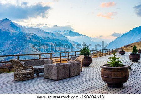 Terrace with beautiful mountain sunset view - stock photo