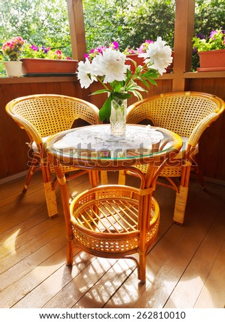 terrace with rattan chairs and table  - stock photo