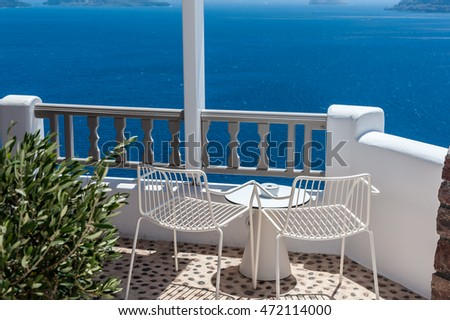 Terrace with two chairs in Santorini - Greece