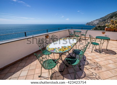 Terraced cafe waiting for guests at the seaside of Amalfi Coast, Italy - stock photo