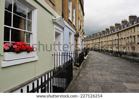 Terraced Georgian Era Town Houses and Stone Paved Walkway in Bath England - stock photo