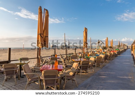 Terraces along the Dutch beach with a view at the famous Pier of Scheveningen - stock photo
