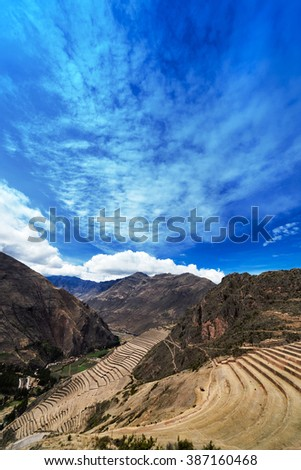 terraces and village in the Andes - stock photo