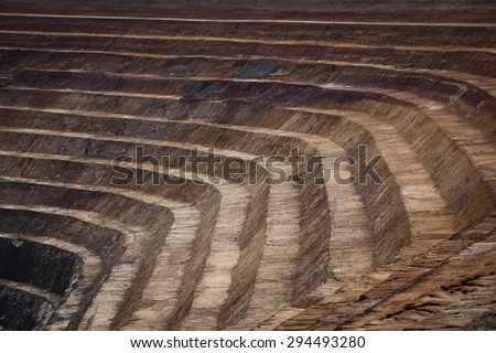 Terraces in open cast mine in New South Wales, Australia. Barrick Cowal Gold Mine. - stock photo