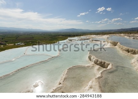 Terraces of Pamukkale in the sun - stock photo