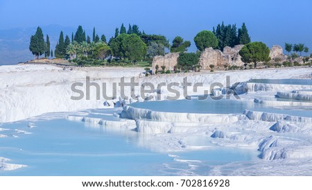 Terraces of travertines filled with water in Pamukkale, Turkey
